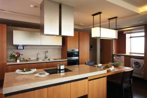 A kitchen or kitchenette at The Classic 500 Pentaz Executive Residence