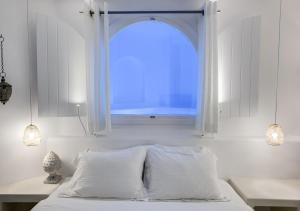 Letto o letti in una camera di Infinity Suites & Dana Villas