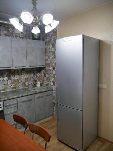 A kitchen or kitchenette at Квартира - студия