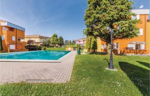 The swimming pool at or near One-Bedroom Apartment in Lugana di Sirmione BS
