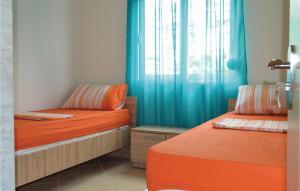 Krevet ili kreveti u jedinici u okviru objekta Apartment Sarande with Sea View 7