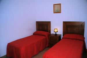 Cama o camas de una habitación en Apartamentos Plaza