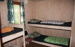 A bunk bed or bunk beds in a room at Holiday home Tingvatn Lokeli Hyttegrend Nr. III