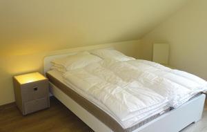Ein Bett oder Betten in einem Zimmer der Unterkunft Holiday Apartment Boiensdorf 04