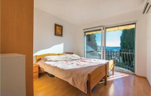 A bed or beds in a room at One-Bedroom Holiday Home in Ankaran