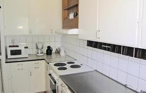 A kitchen or kitchenette at Apartment Köpmansgatan Nissafors