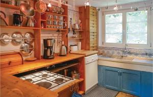 Cuisine ou kitchenette dans l'établissement Holiday home Rue du Herrenberg