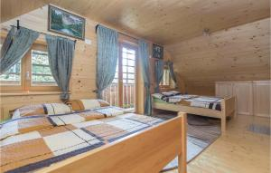 Postelja oz. postelje v sobi nastanitve Three-Bedroom Holiday Home in Gornji Grad