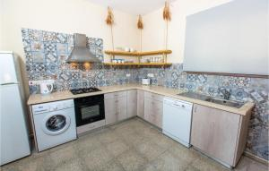 A kitchen or kitchenette at Three-Bedroom Holiday Home in Argaka