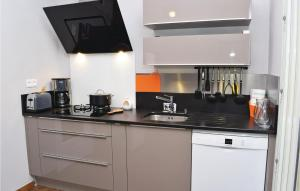 A kitchen or kitchenette at Four-Bedroom Holiday Home in Bagnoles de l'Orne