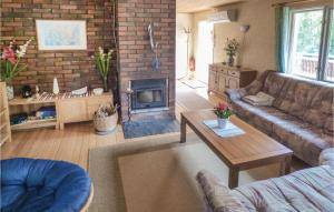 A seating area at Holiday Home Onsala with a Fireplace 04
