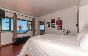 A bed or beds in a room at Holiday home Camino la Caldereta I-672