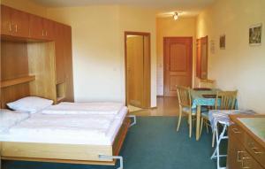 Ein Bett oder Betten in einem Zimmer der Unterkunft Studio Apartment in St. Englmar