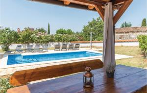 The swimming pool at or near Four-Bedroom Holiday Home in Vabriga