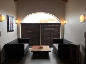A seating area at CotiLoft - Appartement de standing La Cotinière