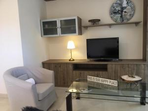 Una televisión o centro de entretenimiento en Apartamento Calma