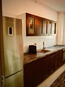 A kitchen or kitchenette at Music Apartment