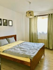 A bed or beds in a room at Music Apartment