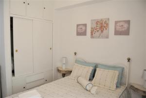 Cama o camas de una habitación en L'appartement IRINA