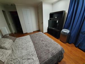 Cama o camas de una habitación en Departamento en suit vista al mar