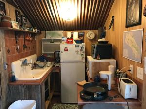 A kitchen or kitchenette at 2 story Barndominium-Treehouse in the woods