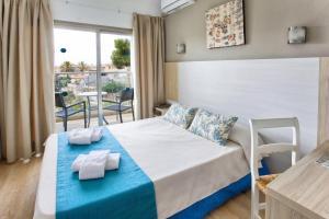 Een bed of bedden in een kamer bij Flacalco Hotel & Apartments