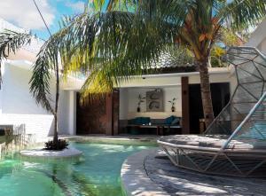 The swimming pool at or near The White Key Luxury Villas