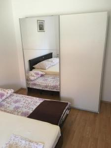 A bed or beds in a room at Apartments Mladenka