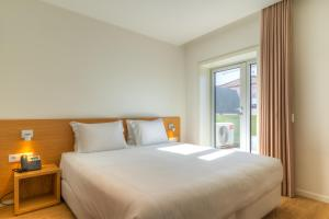 A bed or beds in a room at Spot Family Apartments