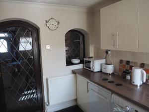 A kitchen or kitchenette at EX-MINERS COTTAGE, BLAENAVON, NEAR ABERGAVENNY