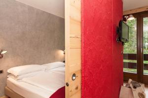 Letto o letti in una camera di Ambiez Residencehotel