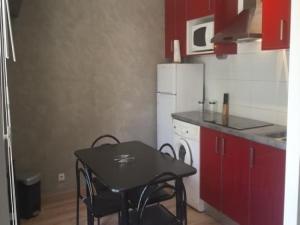 A kitchen or kitchenette at Apartment Pavillon