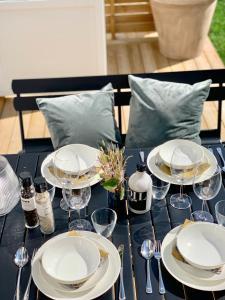 En restaurang eller annat matställe på Easy Livin' Apartment Hotel