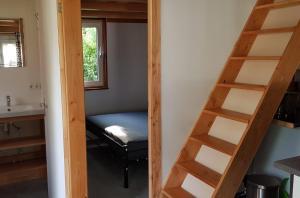 A bed or beds in a room at Chalet - Camping 't Dekske