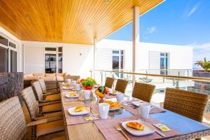 Een restaurant of ander eetgelegenheid bij Villa Capri