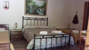 A bed or beds in a room at Andrea Sofi Guesthouse