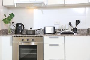 Una cocina o kitchenette en The Point Casa Edificio Boutique