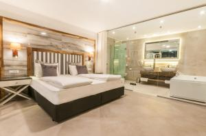A bed or beds in a room at Vila Bisera