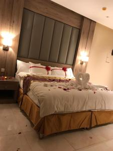 A bed or beds in a room at Lavender Hotel