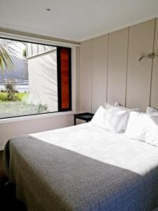 A bed or beds in a room at Braxmere