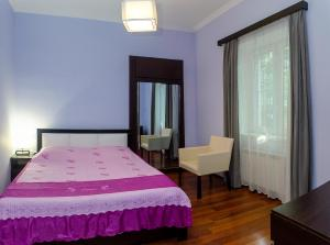 A bed or beds in a room at Apartment Amaghleba