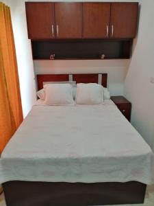 A bed or beds in a room at Apartment in Aqua Palms Resort