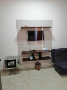 A television and/or entertainment center at Apartment in Aqua Palms Resort