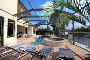 The swimming pool at or close to Holland House Cape Coral, 2732 Southwest 25th Street