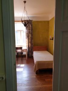 Vuode tai vuoteita majoituspaikassa Villa Alle