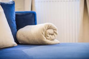 Ein Bett oder Betten in einem Zimmer der Unterkunft Exclusive Apartment La Clemenza di Tito