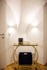 TV/Unterhaltungsangebot in der Unterkunft Exclusive Apartment La Clemenza di Tito