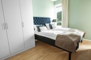 A bed or beds in a room at Wright Apartments - Sørenga