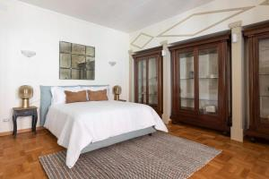 A bed or beds in a room at Sonder — Repubblica