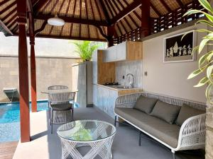 A seating area at Theanna Eco Villa and Spa